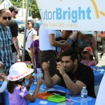 Sunny Verma Showing a Little Girl How the Light Works at the Milton Street Festival!
