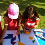 Kids playing with Tangrams at the South End United Soccer Jamboree in July